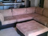 Plush, roomy sectional couch with two matching ottomans