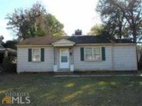 All brick construction, four bedroom/three bath with
