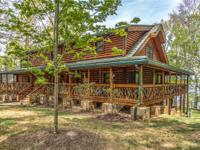 Custom log home with so much to offer-large stone