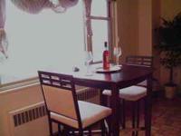 850 sq. feet of hard wood floor. Furniture is classy