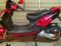 This is a Jonsway 49cc, 4 stroke, red moped/scooter. It