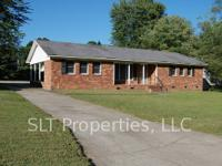 Roomy brick ranch has 3 bdrms, 2 baths, and central