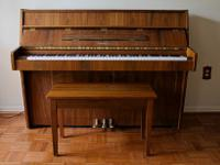 This is a beautiful Kawai tall upright piano and bench