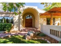 A beautiful Santa Fe style home with amazing mountain