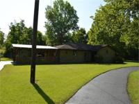 This 3BR/2BA brick home sits on 4.24 acres with