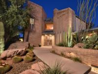 Situated on 2.5 acres of sprawling Sonoran Desert, this