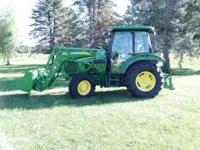 selling John Deere 5085M with deluxe cab and John Deere