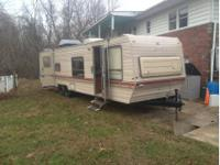 Have a 34ft camper prowler   Looking to trade it or