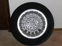 (2) 1987 Ford Mustang wheels with tires. The rims are