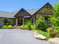 This custom home is noteworthy for its elegant stone