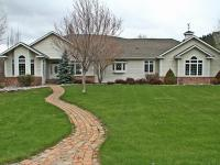 Immaculate custom home sitting on over an acre in the