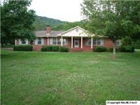 ONE OWNER CUSTOM BUILT BRICK RANCHER IN IMMACULATE