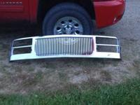 Grille is in good shape, has very little red plasti dip