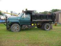"89 Ford F800, Automatic, Diesel engine, 14"" dump bed,"