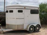 White straight load double axel 2 horse trailer. $1500