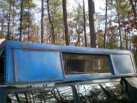8 ft long aluimnum camper shell, it came off of a 1986