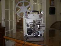 8mm Bell & Howell Projector with full speed control.