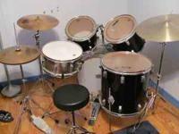 8pc drum set plus extra snare, sticks, seat and more.