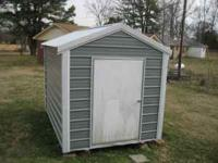 8x12 Metal Shed, excellent condition, $950.00. Call Al