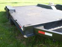 8X14 LOW PROFILE EQUIPMENT TRAILER THAT IS BUMPER PULL.