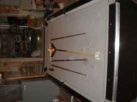 8x5 Slate pool table for sale. Comes with 3 cues,