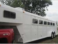 Converted to four horse trailer with nice living area.
