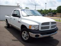This 2004 Dodge 2500 4x2 quad cab is complete with a