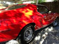 This is a very rare, early 71' AMC Javelin AMX with a