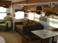 32 ' travel trailer, with 12' slide out couch and