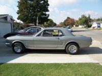 1966 Ford Mustang Coupe. Metallic Silver with two black