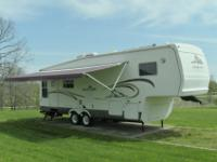 2004 Ceder Creek Silver Back 28 LRLFS, used 30 foot