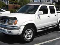 This 2000 Nissan Frontier SV V6 Truck features a 3.3L