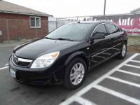 This 2007 Saturn Aura is a very nice car. This clean