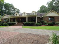 In Town Estate w/ bridge entrance. Total of 9 BR, 6 1/2