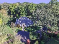 Situated on 4.32 scenic acres in desirable West Carmel,