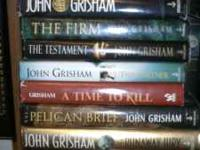 9 John Grisham Books. In good condition mildly used.