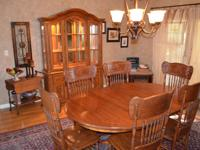 Set includes solid oak table, 6 chairs, lighted hutch