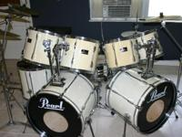 Nice 9 Piece Pearl Export drum set that have Evans