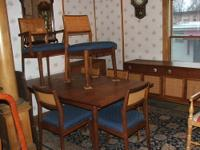 9 piece Danish modern dining set. Table with 6 chairs,