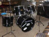 I am selling a 9-Piece Acclaim drum set with throne and