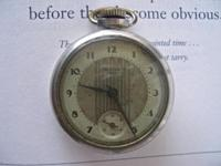This antique Westclox Dax pocket watch includes an