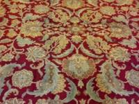 This is a hand knotted rug 100 % Virgin Wool, made in