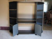This beautiful black entertainment center with gold