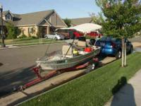 12 foot aluminum boat comes with Bimini top for shade