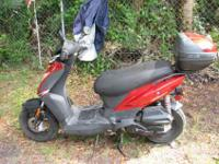 Adult ridden 125 cc scooter that gets 90 MPG. This is