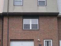 3 bedroom, 1 bath townhouse with 1 car garage. Stove,