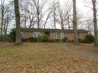 Nice brick ranch home with attached carport. Partial