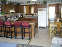 Three bedroom lakefront home including cable and