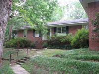 Located in Macon's Shirley Hills, this charming,