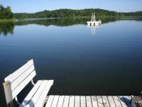 View the sunsets from this 4 acre lakefront refuge